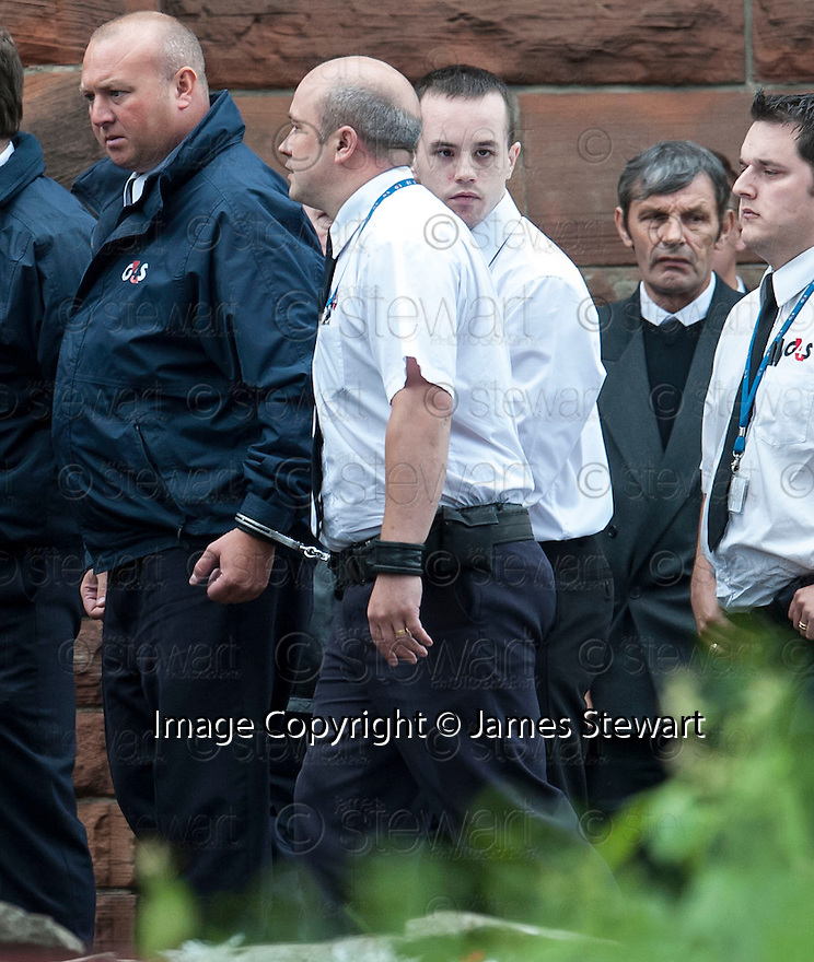 Grandson Kevin Boon, still handcuffed to a G4S officer, arrives for the funeral of former crime family matriarch Mags Haney at St Mary's RC Church in Stirling.