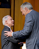 "United States Attorney General Jeff Sessions, left, shakes hands with his successor US Senator Luther Strange (Republican of Alabama) after he completed his testimony before the US Senate Select Committee on Intelligence to  ""examine certain intelligence matters relating to the 2016 United States election"" on Capitol Hill in Washington, DC on Tuesday, June 13, 2017.  In his prepared statement Attorney General Sessions said it was an ""appalling and detestable lie"" to accuse him of colluding with the Russians.<br /> Credit: Ron Sachs / CNP<br /> (RESTRICTION: NO New York or New Jersey Newspapers or newspapers within a 75 mile radius of New York City)"