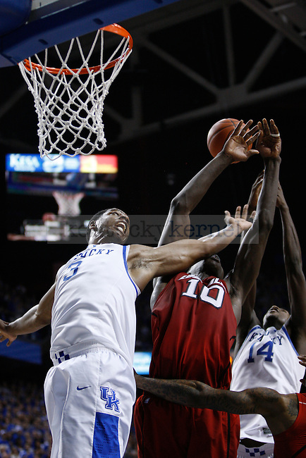 UK's Terrence Jones battles for a rebound against UofL's Gorgui Dieng at Rupp Arena on Saturday, Dec. 31, 2011. Photo by Scott Hannigan | Staff