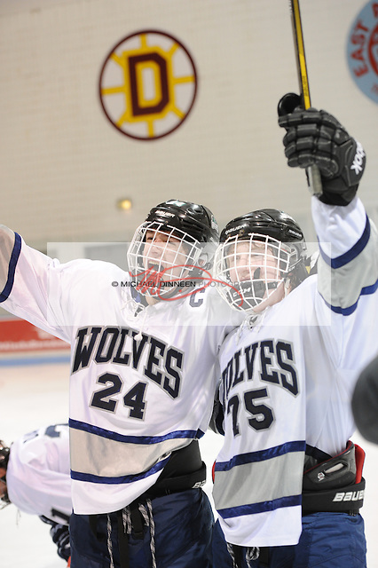 Eagle River captain Connor Canterbury (24) and Ben Rinckey celebrate their 2-1 victory over Service at  Ben Boeke Arena Tuesday, February 2, 2016.  Photo for the Star by Michael Dinneen
