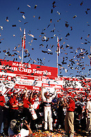Dale Earnhardt celegrates his Million Dollar win in  the Winston 500 at Talladega, AL in October 2000. (Photo by Brian Cleary)