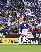 New England Revolution defender Pat Phelan (28) and Cruzeiro midfielder Henrique compete for a high ball.  Brazil's Cruzeiro beat the New England Revolution, 3-0 in a friendly match at Gillette Stadium on June 13, 2010