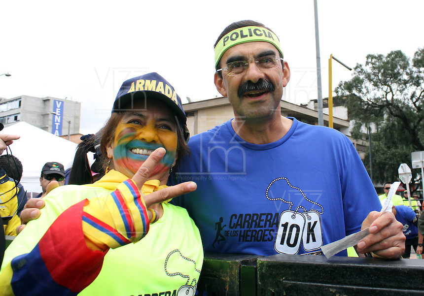 BOGOTA -COLOMBIA. 27-04-2014.  Carrera atlética de Los Heroes 10K , organizada por la Corporacion Matamoros y con la asistencia del presidente Juan Manuel Santos ,el ministro de Defensa  Juan Carlos Pinzon , el director de la Policia Nacional general Rodolfo Palomino y 7000 atletas. Athletic Heroes 10K race organized by the Corporacion Matamoros and with the assistance of President Juan Manuel Santos, Defense Minister Juan Carlos Pinzon, the head of the National Police General Rodolfo Palomino and 7000 athletes.  /.Photo: VizzorImage/ Felipe Caicedo / Staff