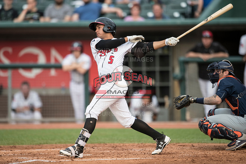 Lansing Lugnuts second baseman Yeltsin Gudino (5) follows through on his swing during the Midwest League baseball game against the Bowling Green Hot Rods on June 29, 2017 at Cooley Law School Stadium in Lansing, Michigan. Bowling Green defeated Lansing 11-9 in 10 innings. (Andrew Woolley/Four Seam Images)