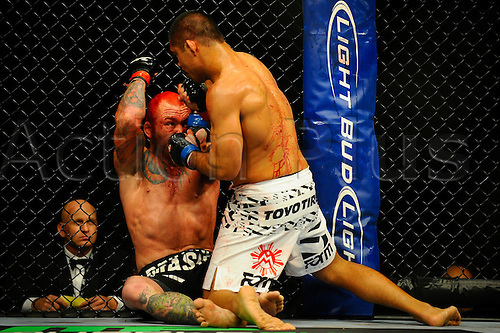 5.11.2011 Birmingham, England. Chris Leben (USA) (Red Hair) fights Mark Munoz (USA) in a Middleweight bout on the Main card during UFC 138: Leben vs. Munoz at the LG Arena. Munoz wins by TKO before the start of the third round after dominating the fight.