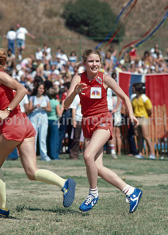 Actress Melissa Gilbert plays football for Team NBC, Battle of the Network Stars, Pepperdine University, Pepperdine, California. November 1979. Photo by John G. Zimmerman