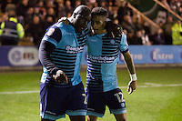 Adebayo Akinfenwa and Paris Cowan-Hall of Wycombe Wanderers celebrate their side's late equaliser during the Sky Bet League 2 match between Plymouth Argyle and Wycombe Wanderers at Home Park, Plymouth, England on 26 December 2016. Photo by Mark  Hawkins / PRiME Media Images.