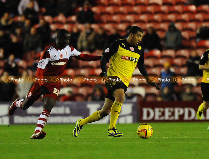 Troy Deeney of Watford battles with Albert Adomah of Middlesbrough - Middlesbrough vs Watford - Sky Bet Championship Football at the Riverside Stadium, Middlesbrough - 09/11/13 - MANDATORY CREDIT: Steven White/TGSPHOTO - Self billing applies where appropriate - 0845 094 6026 - contact@tgsphoto.co.uk - NO UNPAID USE
