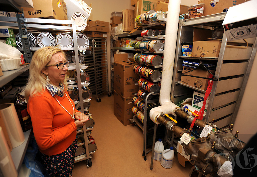 NWA Democrat-Gazette/ANDY SHUPE<br /> Cayla Wilson, director of the Fayetteville Senior Activity and Wellness Center, speaks Friday, April 22, 2016, in the cramped pantry at the center. The center plans an expansion of its kitchen to keep up with the increase in the number of residents for whom they prepare meals.