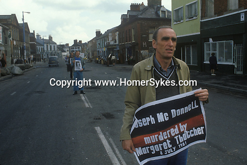 Northern Ireland The Troubles. 1980s. 1981  White Line p silent protest Catholic men hold banners  protesting at Hunger Striker  Joe McDonnells death.