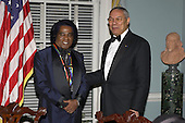 Musician James Brown, left, one of the 2003 Kennedy Center honorees, talking with United States Secretary of State Colin Powell after a dinner in his honor at the United States Department of State in Washington, DC on December 6, 2003..Credit: Robert Trippett - Pool via CNP
