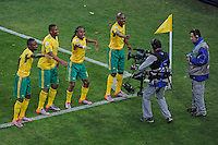 Siphiwe Tshabalala of South Africa (second right) celebrates his goal with team-mates in front of a television camera