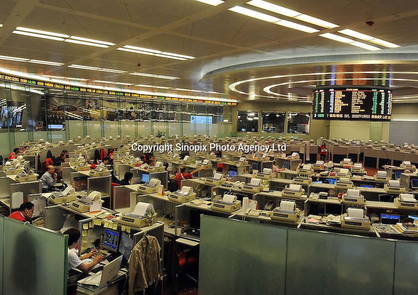 Traders at the Hong Kong Stock Exchange in Hong Kong, China. The Hong Kong Stock Exchange is Asia's third largest stock exchange in terms of market capitalization the Tokyo Stock Exchange and the Shanghai Stock Exchange and fifth largest in the world....................