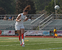Boston Aztec midfielder/defender Morgan Andrews (10) heads the ball.  In a Women's Premier Soccer League (WPSL) match, Boston Aztec (white) defeated Seacoast United Mariners (blue), 2-1, at North Reading High School Stadium on Arthur J. Kenney Athletic Field on on June 23, 2013. Due to injuries through the season, Seacoast United Mariners could only field 10 players.