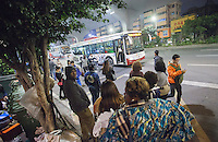 African and Chinese people wait for the bus in an area of Guangzhou known to locals as 'Chocolate City', Guangzhou, Guangdong Province, China, 08 December 2014. The health authorities of Guangzhou are said to be stepping up their monitoring of the African community in light of the ongoing outbreak of the Ebola virus disease in West Africa.