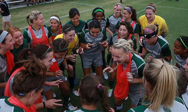 Denton, TX - SEPTEMBER 16: North Texas Mean Green soccer team get ready to takes the field during introductions prior to the match against the Texas Christian University Horned Frogs at the Mean Green Village Soccer Field University in Denton on September 16, 2012 in Denton, Texas. (Photo by Rick Yeatts)