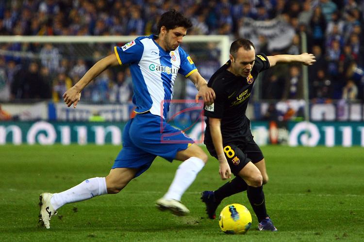 Javi Lopez vs Andres Iniesta.