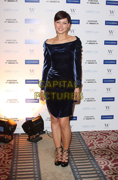 EMMA WILLIS.MTV Staying Alive Foundation Dinner at the Westbury Hotel, Mayfair, London - .January 27th, 2011.full length black dress griffiths blue velvet off the shoulder dress long sleeves black strappy shoes .CAP/ROS.©Steve Ross/Capital Pictures