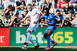 Karim Benzema of Real Madrid (L) fights for the ball with Dakonam Ortega Djene of Getafe CF (R) during the La Liga 2017-18 match between Getafe CF and Real Madrid at Coliseum Alfonso Perez on 14 October 2017 in Getafe, Spain. Photo by Diego Gonzalez / Power Sport Images
