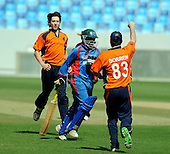 Afghanistan V Netherlands - World T20 Super Four stage qualifying cricket match in Dubai Sports City Cricket Stadium - pics from first innings, Afghanistan batting - Karim Khan Sadiq sprints for the dressing room after being caught off Mark Jonkmann (left) early in the match - Picture by Donald MacLeod 12.02.10