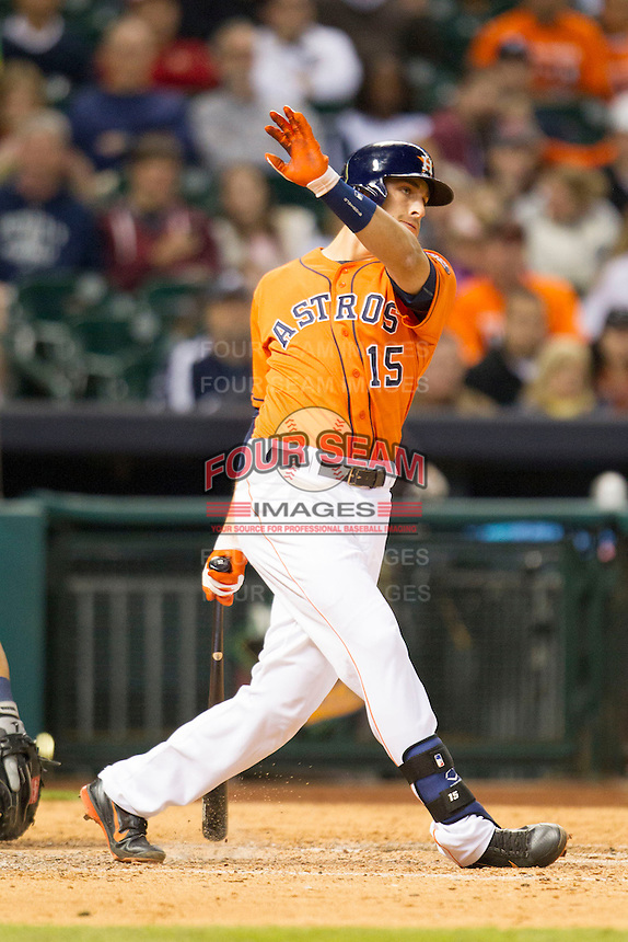Houston Astros designated hitter Jason Castro (15) follows through on his swing during the MLB baseball game against the Detroit Tigers on May 3, 2013 at Minute Maid Park in Houston, Texas. Detroit defeated Houston 4-3. (Andrew Woolley/Four Seam Images).