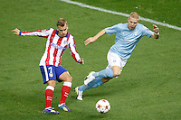 Atletico de Madrid´s Griezmann and Malmo´s Tinnerholm during Champions League soccer match between Atletico de Madrid and Malmo at Vicente Calderon stadium in Madrid, Spain. October 22, 2014. (ALTERPHOTOS/Victor Blanco)