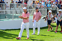 Kevin Chappell (USA) and Charley Hoffman (USA) approach the first tee during round 2 Four-Ball of the 2017 President's Cup, Liberty National Golf Club, Jersey City, New Jersey, USA. 9/29/2017.<br /> Picture: Golffile | Ken Murray<br /> <br /> All photo usage must carry mandatory copyright credit (&copy; Golffile | Ken Murray)