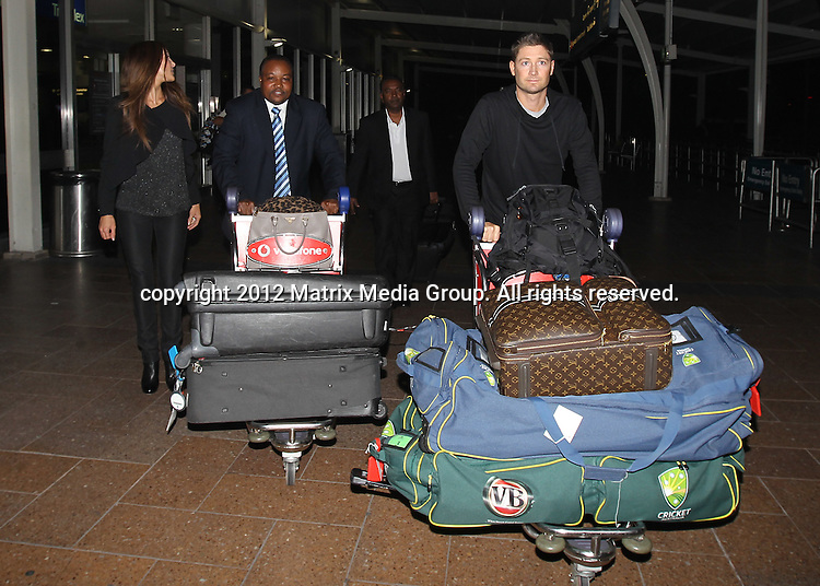 23 May 2012 Sydney, Australia..EXCLUSIVE..Michael Clarke and new wife Kyly Boldy arrive in Sydney from Pune India where Michael was playing for the Pune Warriors IPL Team. Pictured at Sydney International airport.