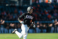 Oregon State Beavers second baseman Andy Armstrong (9) hustles towards first base during a game against the Gonzaga Bulldogs on February 16, 2019 at Surprise Stadium in Surprise, Arizona. Oregon State defeated Gonzaga 9-3. (Zachary Lucy/Four Seam Images)
