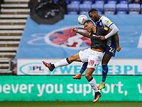 Bolton Wanderers' Josh Magennis competing with Wigan Athletic's Cheyenne Dunkley <br /> <br /> Photographer Andrew Kearns/CameraSport<br /> <br /> The EFL Sky Bet Championship - Wigan Athletic v Bolton Wanderers - Saturday 16th March 2019 - DW Stadium - Wigan<br /> <br /> World Copyright &copy; 2019 CameraSport. All rights reserved. 43 Linden Ave. Countesthorpe. Leicester. England. LE8 5PG - Tel: +44 (0) 116 277 4147 - admin@camerasport.com - www.camerasport.com