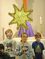 NWA Media/Michael Woods --12/23/2014-- w @NWAMICHAELW...Cole Bednar, age 8, (left and his bother Jake Bednar, age 5, (right) stand next to Emerson McElroy as she holds the star on stage Tuesday morning at St. Joseph Catholic Church in Fayetteville during the rehearsal for the churches Christmas Eve Pageant.