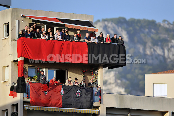 Toulon supporters on a nearby balcony watch the match. European Rugby Champions Cup match, between RC Toulon and Bath Rugby on January 10, 2016 at the Stade Mayol in Toulon, France. Photo by: Patrick Khachfe / Onside Images