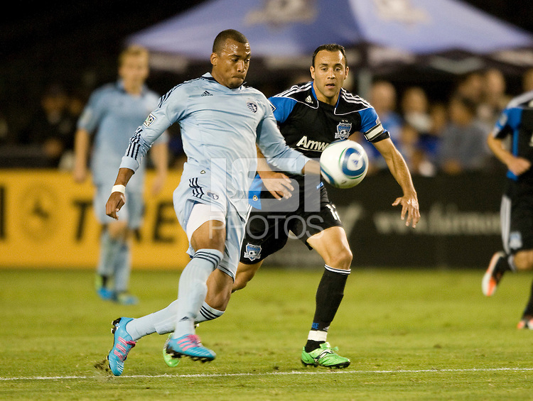 Teal Bunbury of Kansas City controls the ball away from Ramiro Corrales of Earthquakes during the game at Buck Shaw Stadium in Santa Clara. California on October 1st, 2011.  San Jose Earthquakes tied Sporting Kansas City, 1-1.