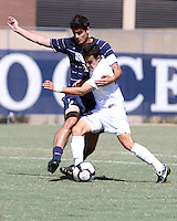 Alex Verdi #12 of Georgetown University tangles with Wesley Curtis #22 of Michigan State during an NCAA match at North Kehoe Field, Georgetown University on September 5 2010 in Washington D.C. Georgetown won 4-0.