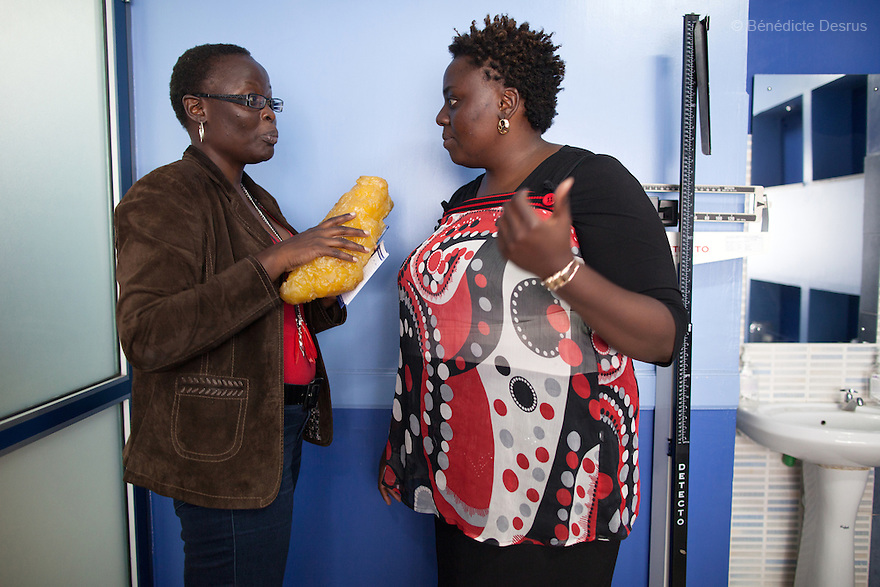 "Alice Ojwang-Ndong, a Kenyan nutritionist and dietetic consultant, shows a model of fatty tissue to Ruth during a weightloss management program in Nairobi, Kenya on December 17, 2012. Ruth Gathu is a 35 year-old Kenyan woman who works as an office administrator. She weighs 299 pounds and weighs 175 centimeters, with a BMI of 44.3. She says: ""In Kenya, people don't spend money on nutrition programs""…""Obesity is in all the social class in Kenya, the rich, the middle class and the poor."" Nairobi has a high prevalence of overweight and obesity among women, especially those in the middle and upper class. Like elsewhere in the world, the main drivers of obesity in Kenya are rapid urbanization and westernization, that have resulted in changing lifestyles such as increased consumption of ""unhealthy diets"" and adoption of sedentary lifestyles. Photo by Bénédicte Desrus"