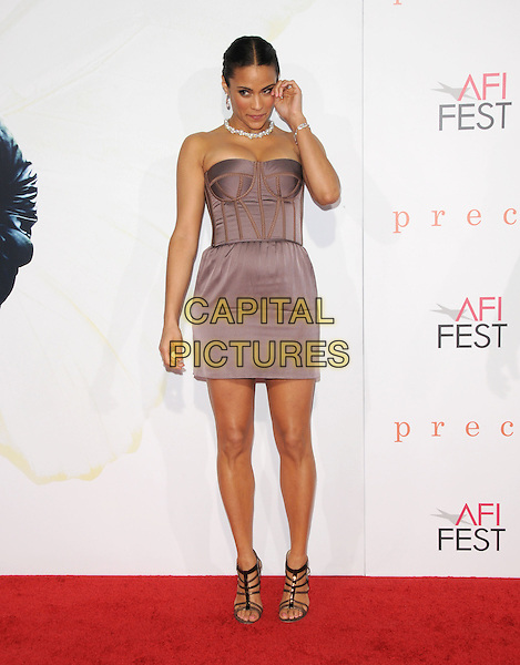 "PAULA PATTON.The 2009 AFI Fest Screening of ""Precious"" held at The Grauman's Chinese Theatre in Hollywood, California, USA..November 1st, 2009.full length purple grey gray corset strapless mini dress hand rubbing eye .CAP/RKE/DVS.©DVS/RockinExposures/Capital Pictures"