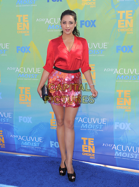 Shay Mitchell.2011 Teen Choice Awards - Arrivals held at Gibson Amphitheatre, Universal City, California, USA..August 7th, 2011.full length red paillettes skirt shirt silk satin black peep toe shoes clutch bag.CAP/RKE/DVS.©DVS/RockinExposures/Capital Pictures.