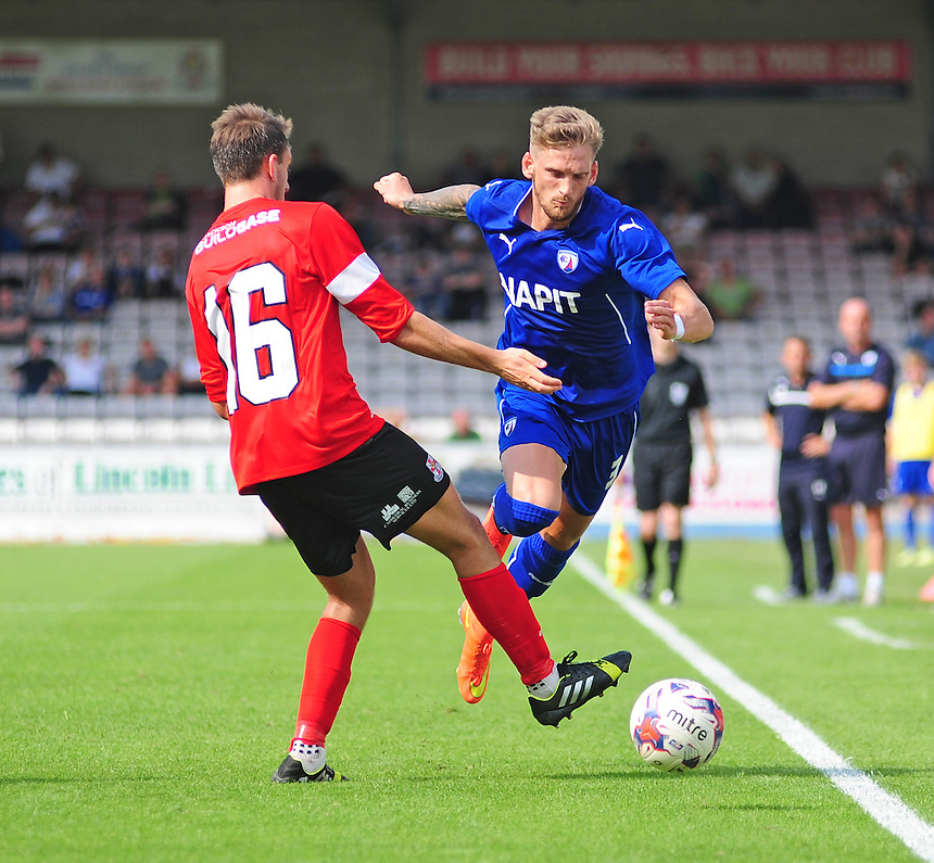 Chesterfield's Daniel Jones is fouled by Lincoln City's Todd Jordan<br /> <br /> Photographer Chris Vaughan/CameraSport<br /> <br /> Football - Friendly - Lincoln City v Chesterfield - Saturday 19th July 2014 - Sincil Bank Stadium - Lincoln<br /> <br /> &copy; CameraSport - 43 Linden Ave. Countesthorpe. Leicester. England. LE8 5PG - Tel: +44 (0) 116 277 4147 - admin@camerasport.com - www.camerasport.com