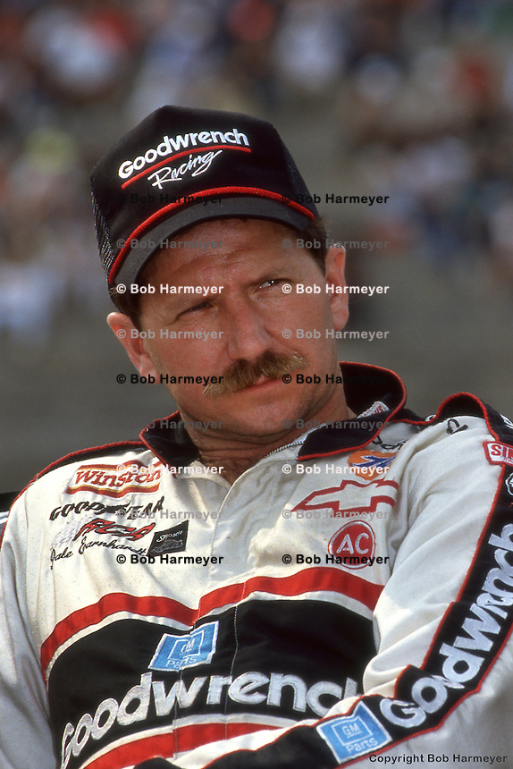CHARLOTTE, NC - OCTOBER 7: Dale Earnhardt in the pit lane during qualifying for the Mello Yello 500 on October 7, 1990, at Charlotte Motor Speedway near Charlotte, North Carolina.