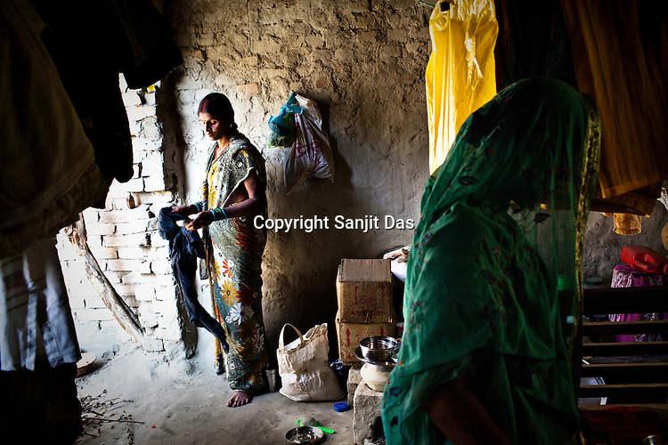 Government health worker, Sangeeta Sinha (40) is seen working on her daily chores in Bishambharpur village, in Muzaffarpur district of Bihar, India. Since 2008 the Foundation and Geneva Global have been investing in the training of medical staff to improve the lives of people living in 600+ villages in the region. The NGOs are delivering cost effective interventions to address treatment, care and prevention of diseases, disability and preventable deaths amongst infants, adolescent girls and women of child-bearing age. There is statistical and anecdotal evidence that there have been vast improvements and a total of 40-50% increased immunization for all children under 6 has meant that communities can be serviced and educated long term. Photograph: Sanjit Das/Panos for Legatum Foundation