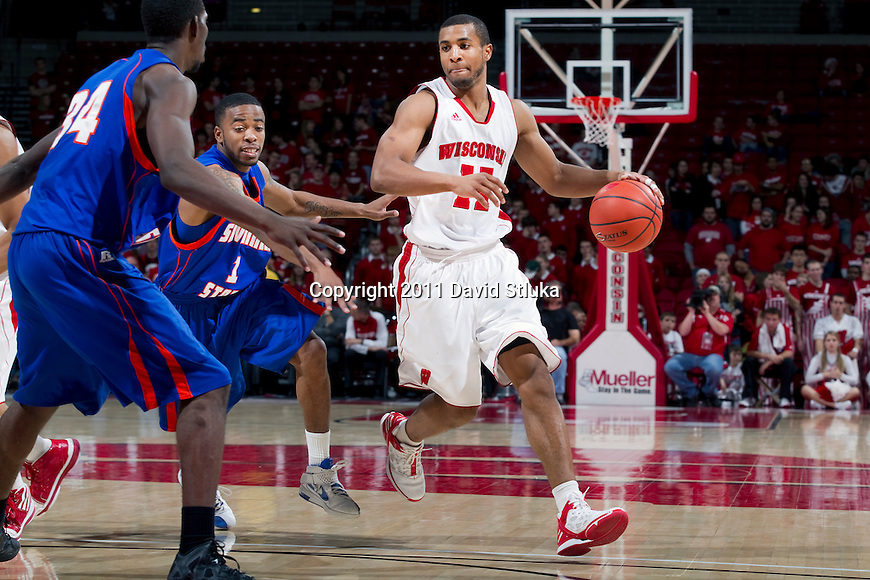Wisconsin Badgers guard Jordan Taylor (12) handles the ball during an NCAA college basketball game against the Savannah State Tigers on December 15, 2011 in Madison, Wisconsin. The Badgers won 66-33. (Photo by David Stluka)
