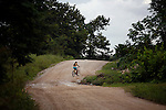 BELIZE - SEPTEMBER 13, 2007:  A girl rides her bike up the Southern Highway on September 13, 2007 in Belize.  (PHOTOGRAPH BY MICHAEL NAGLE)