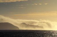 fog rolling of shore