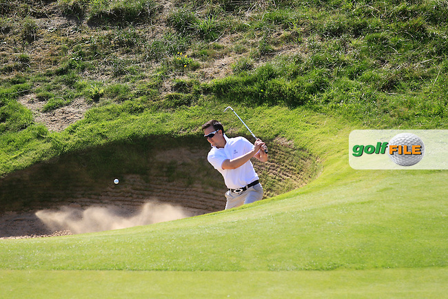 Kenny McGarry (Castlemartyr) playing out of a bunker on the 8th during Round 1 of The South of Ireland in Lahinch Golf Club on Saturday 26th July 2014.<br /> Picture:  Thos Caffrey / www.golffile.ie