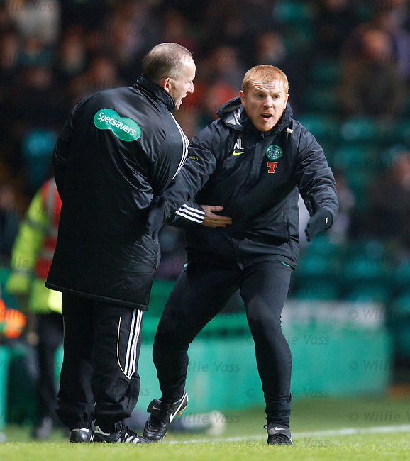 Neil Lennon restrained by the fourth official as he goes ballistic