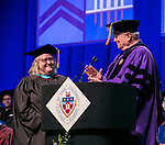 Donna Max receives a Via Sapientiae Award from Helmut P. Epp, professor, former dean and former provost, Sunday, June 11, 2017, during the DePaul University College of Computing and Digital Media and the College of Communication commencement ceremony at the Allstate Arena in Rosemont, IL. (DePaul University/Jamie Moncrief)