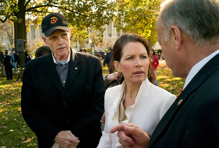 "WASHINGTON, DC - Nov. 07: Jim Martin, president of the 60 Plus Association, Rep. Michele Bachmann, R-Minn., and Rep. Steve King, R-Iowa, talk before a ""House Call"" rally sponsored by House Republicans in opposition to the health care reform bill being debated in the House. (Photo by Scott J. Ferrell/Congressional Quarterly)"