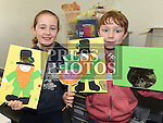 Sophie and Tomás Everitt at the St. Patrick's day art workshop in the library. Photo:Colin Bell/pressphotos.ie