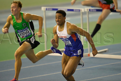 27.02.2016. EIS Sheffield, Sheffield, England. British Indoor Athletics Championships Day One. David Omorogie crossing the line in a 60m Hurdles heat.