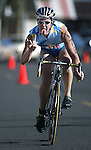 An unidentified rider competes in the Reno Sparks Lake Tahoe Triathlon Aug. 16, 2003 at the Sparks Marina in Sparks, Nev..Photo by Cathleen Allison